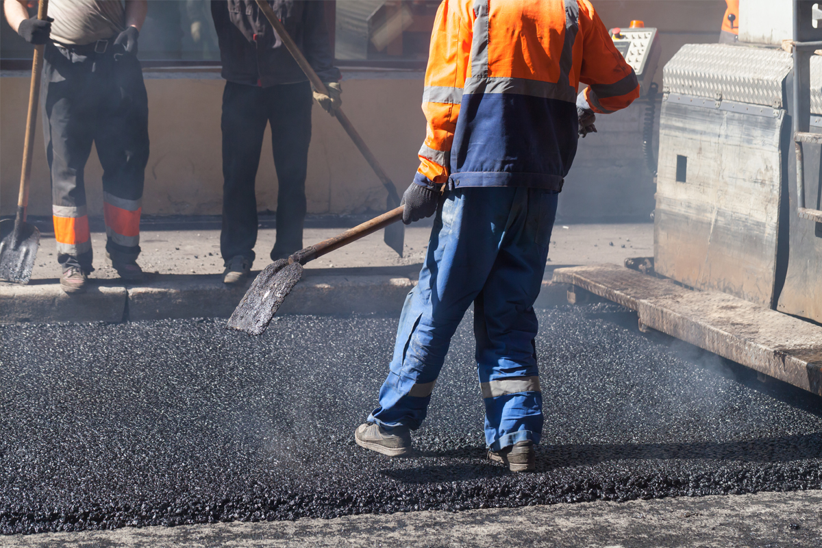 Mullins Crew applying a layer of asphalt