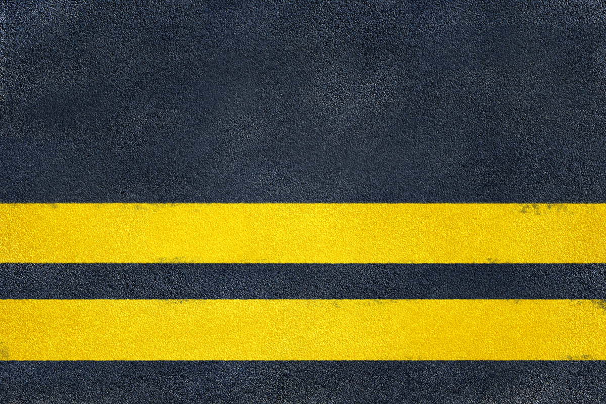 Yellow stripes on asphalt
